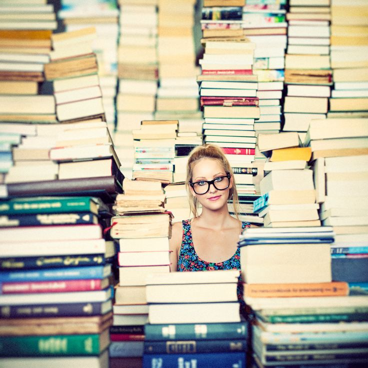 Woman surrounded by stacks of books